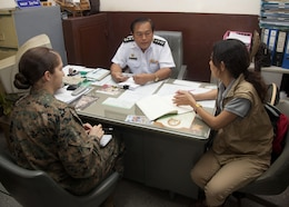 U.S. Marine Lance Cpl. Kylie Curtis with Civil Affairs Attachment, G3 Operations, III Marine Expeditionary Force speaks to Chaluay Wijarat, Station Master of the Phitsanulok train station. The Marines visited the Phitsanulok train station and bus terminal to determine their capabilities in Phitsanulok, Kingdom of Thailand, on Feb. 06, 2014 during exercise Cobra Gold 2014 (CG 14). CG 14, in its 33rd iteration, demonstrates the U.S. and the Kingdom of Thailand's commitment to our long-standing alliance and regional partnership, prosperity and security in the Asia-Pacific region. (U.S. Marine Corps photo by Lance Cpl. Leah Agler/ Released)
