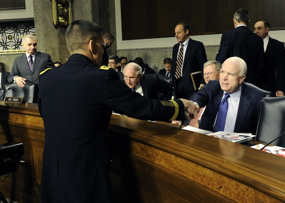 DIA Director Army Lt. Gen. Michael Flynn is greeted by Sen. John McCain prior to testifying before the Senate Armed Forces Committee Feb. 11. Photos by DIA Public Affairs