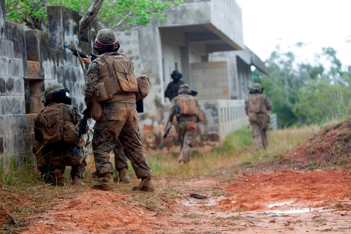 Marines with Weapons Company, Battalion Landing Team 2nd Battalion, 5th Marines, 31st Marine Expeditionary Unit, sweep buildings for enemy forces during urban combat training here, Feb 8. The Marines utilized 5.56mm Special Effects Small Arms Marking System (SESAMS) rounds and a Military Operations on Urban Terrain facility to simulate actual combat. The 31st MEU is the Marine Corps' force in readiness in the Asia-Pacific region and is the only continuously forward-deployed MEU.