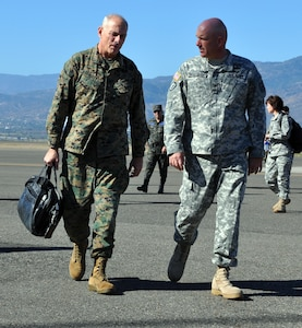 U.S. Army Col. Thomas Boccardi, Joint Task Force-Bravo Commander, greets U.S. Marine Corps Gen. John F. Kelly, Commander, U.S. Southern Command, on the flightline at Soto Cano Air Base, Honduras, Feb. 11, 2014. Kelly is visiting Honduras during the week to meet with U.S. and Honduran military and civilian leaders within the country. (U.S. Air Force photo by Capt. Zach Anderson)