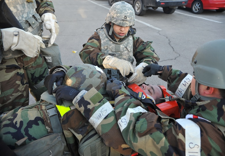 Members of the 51st Medical Group Field Response Team finish securing a mock casualty in a head immobilization apparatus as part of a mass casualty scenario outside Bldg. 938 during Operational Readiness Exercise Beverly Midnight 14-02 at Osan Air Base, Republic of Korea, Feb. 11, 2014. The 51st Comptroller Squadron post-attack reconnaissance team performed self aid and buddy care on 11 role players before the arrival of the FRT. (U.S. Air Force photo/Airman 1st Class Ashley J. Thum)