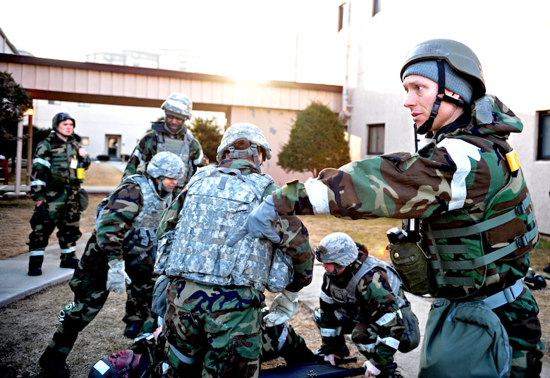 "A member of the 51st Medical Group Field Response Team directs the separation of simulated casualties into ""immediate"" and ""delayed"" categories at the casualty collection point as part of a mass casualty scenario outside Bldg. 938 during Operational Readiness Exercise Beverly Midnight 14-02 at Osan Air Base, Republic of Korea, Feb. 11, 2014. Role players were then tagged to allow emergency room personnel to simulate treating the most critically injured first upon their arrival at the 51st MDG. (U.S. Air Force photo/Airman 1st Class Ashley J. Thum)"