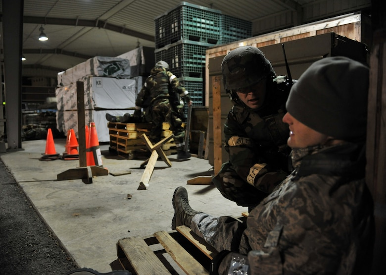 A member of the 51st Logistics Readiness Squadron Traffic Management Office triage team checks on the consciousness of a simulated explosion casualty during Beverly Midnight 14-02 at Osan Air Base, Republic of Korea, Feb. 11, 2014. The triage team tended to the wounds of five different role players during this particular exercise scenario. (U.S. Air Force photo/Senior Airman Siuta B. Ika)
