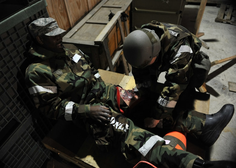 A member of the 51st Logistics Readiness Squadron Traffic Management Office triage team tends to a leg wound on a simulated explosion casualty during Beverly Midnight 14-02 at Osan Air Base, Republic of Korea, Feb. 11, 2014. The triage team was responsible for applying the proper medical care to each victim before transporting them to receive additional aid at the hospital. (U.S. Air Force photo/Senior Airman Siuta B. Ika)