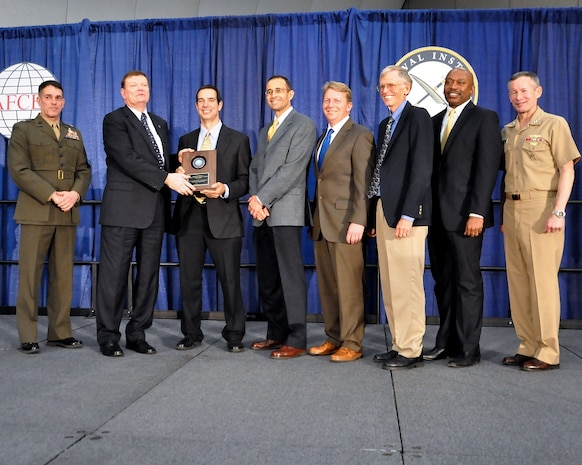 From left, Brig. Gen. Kevin Nally, deputy chief information officer for the Marine Corps; Terry Halvorsen, Department of the Navy chief information officer; and Vice Adm. Ted Branch (far right), deputy chief of Naval Operations for Information Dominance and director of Naval Intelligence, present the DON Information Management-Information Technology Excellence Award to the DON Next-Generation Enterprise Network Contract Source Selection Team. The Navy/Marine Corps team supported the successful evaluation and award of the multi-billion-dollar NGEN contract. The award was presented Feb. 11 in San Diego during AFCEA West.