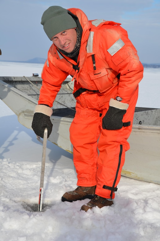 Al VanGuilder, from St. Paul District Operations Division, measures ice thickness on Lake Pepin near Wabasha, Minn., Feb. 13, 2013.