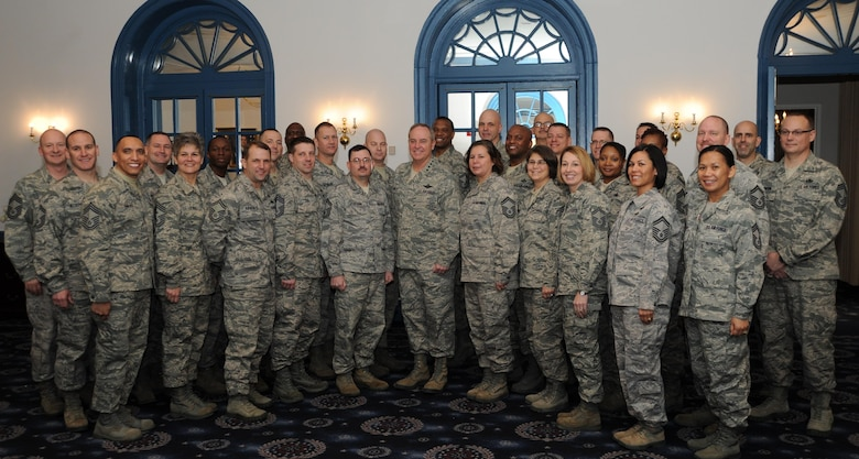 Air Force Chief of Staff Gen. Mark A. Welsh III poses for a photo with Air Force District of Washington chief master sergeant selects and new chief master sergeants during the chief orientation seminar at Feb. 7, 2014, at Joint Base Anacostia-Bolling, D.C. During the five-day event, attendees heard from Air Force senior leaders and discussed a range of topics from civilian personnel to being a resilient leader. (U.S. Air Force photo/Master Sgt. Tammie Moore)
