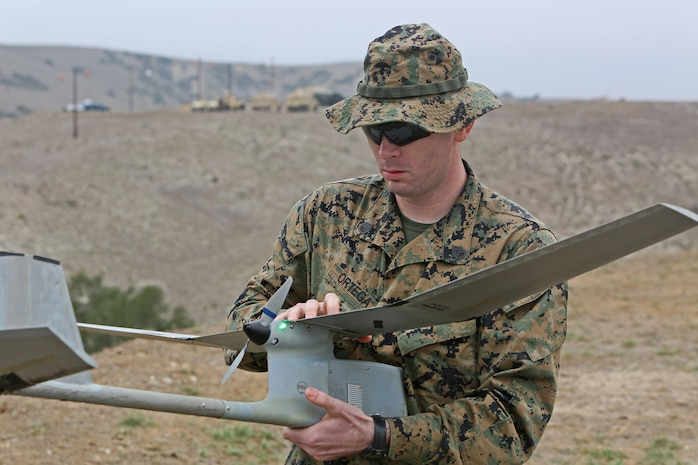 Staff Sgt. Juan-Ricardo Ortega, an infantry unit leader with Marine Corps Security Forces Battalion, inspects an unmanned aerial vehicle after a landing during a UAV training course aboard Camp Pendleton, Calif., Jan. 31, 2014. The UAV course is two weeks long and focuses on familiarizing Marines and sailors with the equipment primarily through practical application.