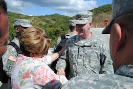 Jacksonville District Commander Col. Alan Dodd receives congratulations from the mayor of Ponce, Puerto Rico, Maria Eloisa Melendez Altieri following a dedication ceremony held at Portugues Dam Feb. 5.  The $386 million dam is expected to help reduce impacts from flooding for 40,000 people living in and around Ponce.