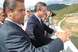 Pablo Vazquez-Ruiz, resident engineer overseeing construction at Portugues Dam, shows the dam's spillway to Puerto Rico Governor Alejandro Garcia Padilla following a dedication ceremony celebrating completion of construction Feb. 5. The $386 million dam is the first roller-compacted concrete dam built by the U.S. Army Corps of Engineers.