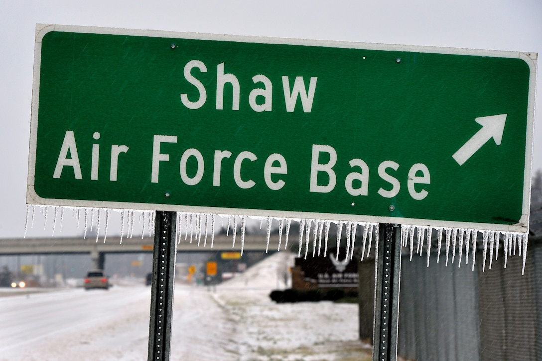 "Icicles form on a Shaw Air Force Base roadway sign just outside of Shaw's main gate, Feb. 12, 2014. Though severe winter weather is rare at Shaw, this winter season has presented a fair amount of snow, sleet and ice. More than once this winter season, Shaw AFB has had to reduce its manning to ""Mission Essential Personnel"" only due to forecasted inclement weather. Team Shaw personnel are urged to stay off the roadways. Also, the 20th Fighter Wing safety team reminds all personnel to refer to winter safety tips when operating in the inclement winter environment. (U.S. Air Force Photo by Staff Sgt. Kenny Holston/Released)"