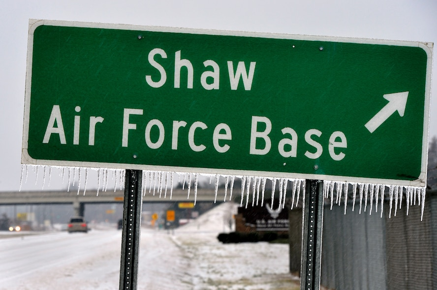 """Icicles form on a Shaw Air Force Base roadway sign just outside of Shaw's main gate, Feb. 12, 2014. Though severe winter weather is rare at Shaw, this winter season has presented a fair amount of snow, sleet and ice. More than once this winter season, Shaw AFB has had to reduce its manning to """"Mission Essential Personnel"""" only due to forecasted inclement weather. Team Shaw personnel are urged to stay off the roadways. Also, the 20th Fighter Wing safety team reminds all personnel to refer to winter safety tips when operating in the inclement winter environment. (U.S. Air Force Photo by Staff Sgt. Kenny Holston/Released)"""