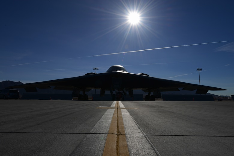 A B-2 Spirit from the 13th Bomb Squadron, Whiteman Air Force Base, Mo., sits on the flightline Feb. 11, 2014, at Nellis AFB, Nev. The 13th BS is at Nellis AFB to participate in the premier combat exercise Red Flag 14-1 Jan. 27 to Feb. 14. During Red Flag training missions, the B-2 Spirit aircrews practice infiltrating contested enemy airspace and destroying high value targets.  By providing realistic combat training in a contested, degraded and operationally limited environment, Red Flag 14-1 provides pilots with real-time war scenarios and helps ground crews test their readiness capabilities. (U.S. Air Force photo by Senior Airman Benjamin Sutton/Released)