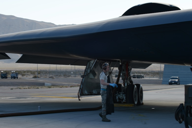 Airman 1st Class Matthew Helms, 509th Aircraft Maintenance Squadron crew chief from Whiteman Air Force Base, Mo., walks beneath a B-2 Spirit after completing routine maintenance Feb. 10, 2014, at Nellis AFB, Nev. Helms is at Nellis AFB, participating in the combat exercise Red Flag 14-1. Red Flag missions present many challenges to test the aircrew's ability to execute its mission anytime in an operationally contested and degraded environment. (U.S. Air Force photo by Senior Airman Benjamin Sutton/Released)