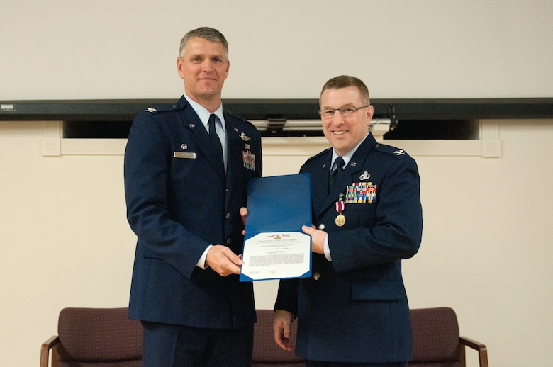 Col. Jeffrey Peters, the outgoing commander of the 123rd Mission Support Group, receives a Meritorious Service Medal from Col. Barry Gorter, commander of the 123rd Airlift Wing, during Peters' retirement ceremony at the Kentucky Air National Guard Base in Louisville, Ky., Jan. 11, 2014. Peters served in the U.S. Air Force and Air National Guard for 28 years. (U.S. Air National Guard photo by Airman 1st Class Joshua Horton)