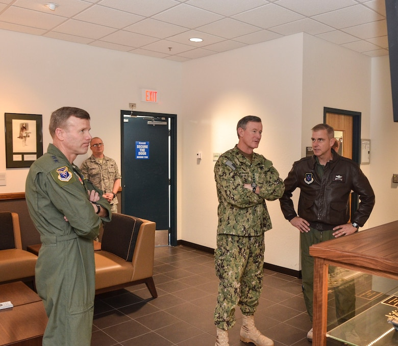 U.S. Navy Admiral William McRaven (center), Commander of U.S. Special Operations Command (USSOCOM), receives a briefing on the 612th Air and Space Operations Center from the Col. Bradley Pickens, 612th AOC deputy commander, during a visit to Davis-Monthan AFB, Ariz., Feb. 7, 2014. During his visit, visit, the admiral toured of the 612th AOC and spoke with AFSOUTH Airmen about their mission as the air component of U.S. Southern Command.   (U.S. Air Force photo by Staff Sgt. Adam Grant/Released)