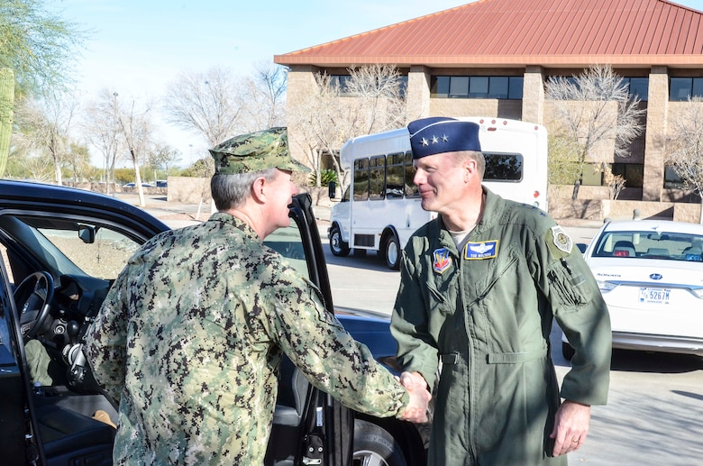 U.S. Navy Admiral William McRaven (left), Commander of U.S. Special Operations Command, greets U.S. Air Force Lt. Gen. Tod Wolters, 12th Air Force (Air Forces Southern) commander, upon arrival to Davis-Monthan AFB, Ariz., Feb. 7, 2014. During the visit, the admiral toured of the 612th Air and Space Operations Center and, spoke with AFSOUTH Airmen about their mission as the air component of U.S. Southern Command. (U.S. Air Force photo by Staff Sgt. Adam Grant/Released)