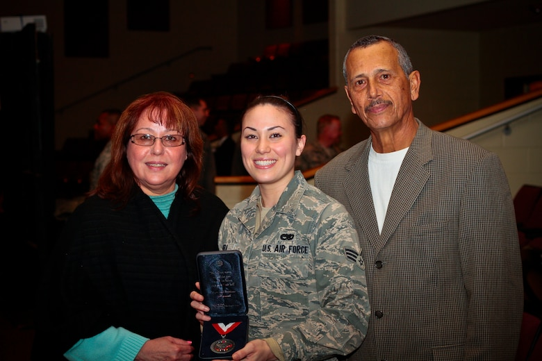 "U.S. Air Force Senior Airman Monica Rivera from the New Jersey Air National Guard's 177th Fighter Wing presents her mother Diana with a ""center of influence"" award at the Hometown Heroes Salute event at Absegami High School in Galloway, N.J. on Feb. 9.  (U.S. Air National Guard photo by Tech. Sgt. Matt Hecht/Released)"