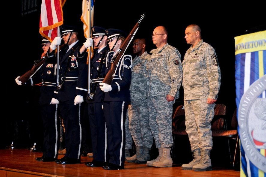U.S. Air Force airmen from the New Jersey Air National Guard's 177th Fighter Wing Honor Guard place the colors at the beginning of the Hometown Heroes Salute awards presentation at Absegami High School in Galloway, N.J. on Feb. 9.  (U.S. Air National Guard photo by Airman 1st Class Shane Karp/Released)