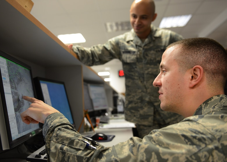 "First Lieutenant David DeMeuse, 31st Operations Support Squadron Weather Flight commander points out a cloud pattern over Italian airspace to Staff Sgt. Charles Washington, 31st OSS weather flight member, Jan. 30, 2014, at Aviano Air Base, Italy. The weather flight employs the ""eyes forward"" approach using real-time radar, satellite imagery, sensor readouts and visual observations to tailor weather conditions specifically for the 31st Fighter Wing. (U.S. Air Force photo/Airman 1st Class Ryan Conroy)"