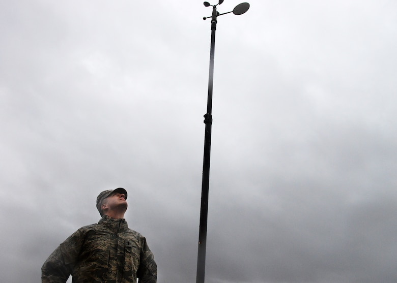 First Lieutenant  David DeMeuse, 31st Operations Support Squadron Weather Flight commander, observes a TMQ-53 automated observing weather station during a rainstorm, Jan. 30, 2014, at Aviano Air Base, Italy. The weather station automatically takes readings and processes them through a computer, which provides weather technicians more time to analyze weather data. (U.S. Air Force photo/Airman 1st Class Ryan Conroy)