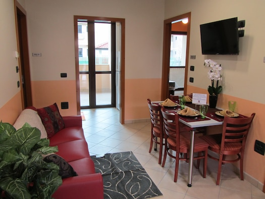 The Air Force Civil Engineer Center recently completed construction of a $15.4 million dormitory at Aviano Air Base, Italy.. The new three-story dorm houses 144 Airmen and features a quad room layout, providing every four Airmen with private bedrooms and bathrooms and a shared living, dining and kitchen area. (U.S. Air Force photo)