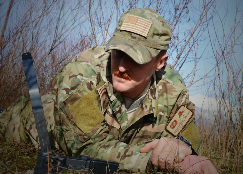 Staff Sgt. Claude Brown, 31st Operations Support Squadron survival, evasion, recovery and escape specialist, waits for a radio response from 31st Fighter Wing pilots during a simulated combat search and rescue mission, Jan. 28, 2014, at Cellina Meduna training ground near Maniago, Italy. (U.S. Air Force photo/Airman 1st Class Ryan Conroy)