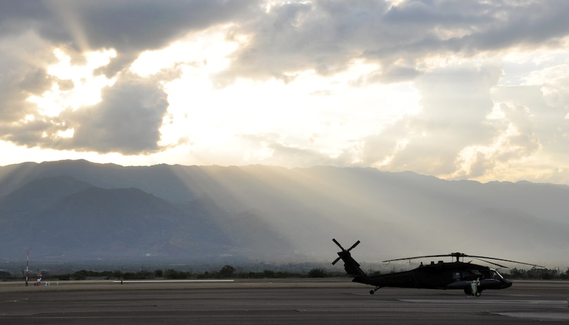 A UH-60 Blackhawk helicopter assigned to Joint Task Force-Bravo's 1-228th Aviation regiment sits on the flightline as the sun sets at Soto Cano Air Base, Honduras, Feb. 12, 2014. Joint Task Force-Bravo utilizes UH-60 and CH-47 aircraft to execute a wide variety of mission sets in order to work with our Honduran host-nation partners to enhance regional security, stability, and cooperation. (U.S. Air Force photo by Capt. Zach Anderson)