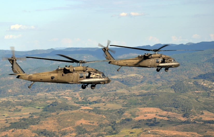 A pair of UH-60 Blackhawk helicopters assigned to Joint Task Force-Bravo's 1-228th Aviation Regiement cruise over the Honduran landscape, Feb. 12, 2014. The two aircraft were transporting a delegation of several U.S. and Honduran distinguished visitors, including U.S. Marine Corps. Gen. John F. Kelly, Commander, U.S. Southern Command, and U.S. Ambassador to Honduras Lisa Kubiske, to visits to multiple Honduran military installations throughout the country. (U.S. Air Force photo by Capt. Zach Anderson)