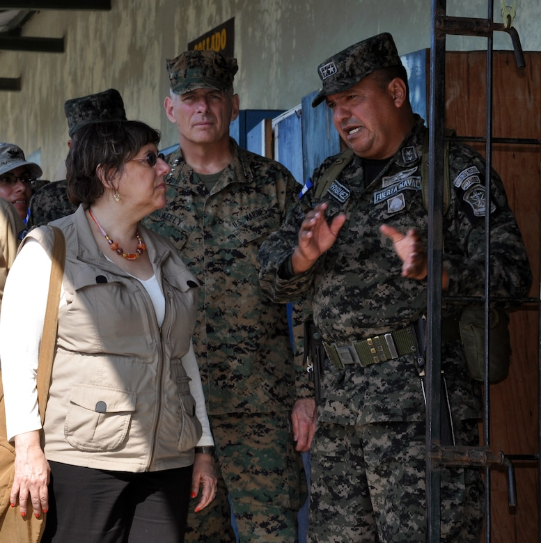 U.S. Marine Corps Gen. John F. Kelly, Commander, U.S. Southern Command, and U.S. Ambassador to Honduras Lisa Kubiske, visit with a Honduran military member while touring Honduran marine base at La Ceiba, Honduras, Feb. 12, 2014.  Kelly and a delegation of U.S. Department of State and U.S. and Honduran military leaders, including Kubiske, Honduran Maj. Gen. Fredy Diaz, Joint Chief of the Honduran Military, and Honduran Rear Admiral Hector Caballero, Honduran Navy Commander, spent the day visiting several Honduran military facilities. Throughout the day, the delegation received briefings and had the opportunity to discuss issues with Honduran military leadership. Transportation for the day was provided by UH-60 Blackhawk helicopters from Joint Task Force-Bravo's 1-228th Aviation Regiment. (U.S. Air Force photos by Capt. Zach Anderson)