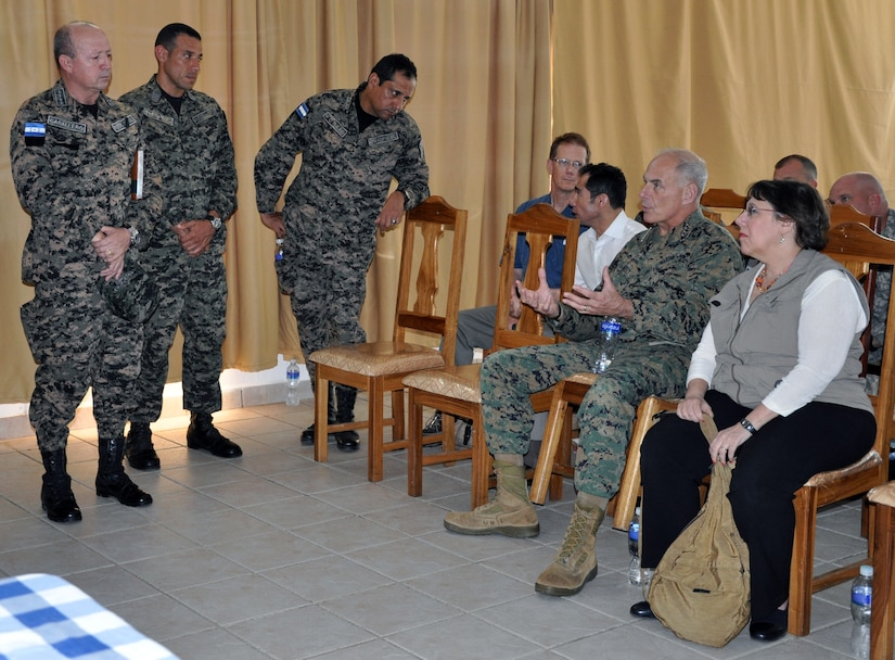 U.S. Marine Corps Gen. John F. Kelly, Commander, U.S. Southern Command, and U.S. Ambassador to Honduras Lisa Kubiske, speak with Honduran military leaders following a briefing at a Honduran naval base at Puerto Castilla, Honduras, Feb. 12, 2014.  Kelly and a delegation of U.S. Department of State and U.S. and Honduran military leaders, including Kubiske, Honduran Maj. Gen. Fredy Diaz, Joint Chief of the Honduran Military, and Honduran Rear Admiral Hector Caballero, Honduran Navy Commander, spent the day visiting several Honduran military facilities. Throughout the day, the delegation received briefings and had the opportunity to discuss issues with Honduran military leadership. Transportation for the day was provided by UH-60 Blackhawk helicopters from Joint Task Force-Bravo's 1-228th Aviation Regiment. (U.S. Air Force photos by Capt. Zach Anderson)