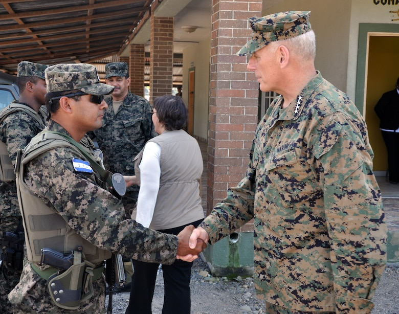 U.S. Marine Corps Gen. John F. Kelly, Commander, U.S. Southern Command, visits with a member of the Honduran military while touring a Honduran marine base at La Ceiba, Honduras, Feb. 12, 2014.  Kelly and a delegation of U.S. Department of State and U.S. and Honduran military leaders, including U.S. Ambassador to Honduras Lisa Kubiske, Honduran Maj. Gen. Fredy Diaz, Joint Chief of the Honduran Military, and Honduran Rear Admiral Hector Caballero, Honduran Navy Commander, spent the day visiting several Honduran military facilities. Throughout the day, the delegation received briefings and had the opportunity to discuss issues with Honduran military leadership. Transportation for the day was provided by UH-60 Blackhawk helicopters from Joint Task Force-Bravo's 1-228th Aviation Regiment. (U.S. Air Force photos by Capt. Zach Anderson)
