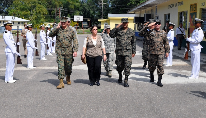 U.S. Marine Corps Gen. John F. Kelly, Commander, U.S. Southern Command, U.S. Ambassador to Honduras Lisa Kubiske, Honduran Maj. Gen. Fredy Diaz, Joint Chief of the Honduran Military, and Honduran Rear Admiral Hector Caballero, Honduran Navy Commander, are greeted by an honor guard upon their arrival at the Honduran Naval Academy at La Ceiba, Honduras, Feb. 12, 2014. Kelly and Kubiske, along with a delegation of U.S. Department of State and U.S. and Honduran military leaders, spent the day visiting several Honduran military installations throughout the country. Transportation was provided by UH-60 Blackhawks from Joint Task Force-Bravo's 1-228th Aviation Regiment. (U.S. Air Force photo by Capt. Zach Anderson)