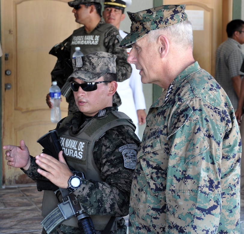 U.S. Marine Corps Gen. John F. Kelly, Commander, U.S. Southern Command, visits with a member of the Honduran military while touring a Honduran Naval installation at La Ceiba, Honduras, Feb. 12, 2014.  Kelly and a delegation of U.S. Department of State and U.S. and Honduran military leaders, including U.S. Ambassador to Honduras Lisa Kubiske, Honduran Maj. Gen. Fredy Diaz, Joint Chief of the Honduran Military, and Honduran Rear Admiral Hector Caballero, Honduran Navy Commander, spent the day visiting several Honduran military facilities. Throughout the day, the delegation received briefings and had the opportunity to discuss issues with Honduran military leadership. Transportation for the day was provided by UH-60 Blackhawk helicopters from Joint Task Force-Bravo's 1-228th Aviation Regiment. (U.S. Air Force photos by Capt. Zach Anderson)