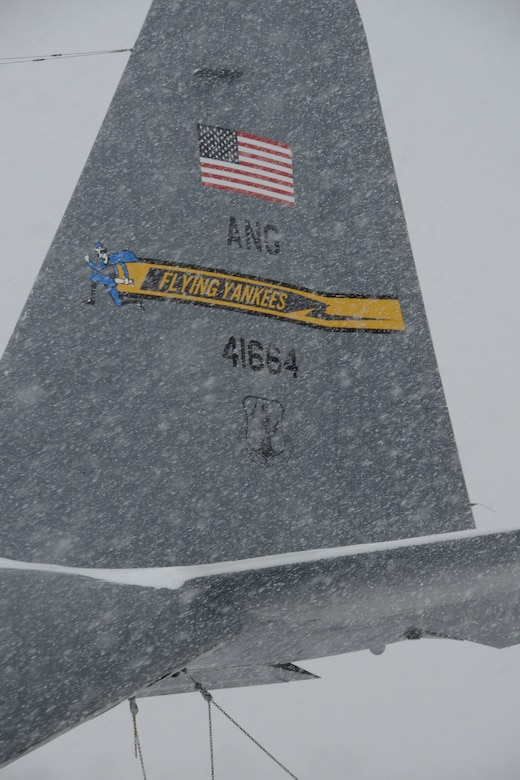 Snow rapidly accumulates on a C-130H aircraft assigned to the 103rd Airlift Wing during a nor'easter at Bradley Air National Guard Base, East Granby, Conn., Feb. 13, 2014. More than 200 Airmen reported to work here and at the Orange Air National Guard Station, ready to answer the call in the event the state required assistance during the height of the storm.  (U.S. Air National Guard photo by Maj. Bryon M. Turner)
