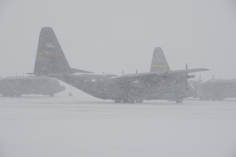 Three C-130H aircraft assigned to the 103rd Airlift Wing weather the storm during near whiteout conditions at Bradley Air National Guard Base, East Granby, Conn., as crews work to clear the flightline of the rapidly accumulating snow from a nor'easter Feb. 13, 2014. More than 200 Airmen reported to work here and at the Orange Air National Guard Station, ready to answer the call in the event the state required assistance during the height of the storm.  (U.S. Air National Guard photo by Maj. Bryon M. Turner)