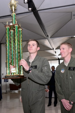 Cadets 2nd Class George Antoniou (left) and Nathan Dickey hoist the 2013 NIFA Regional Competition trophy at Mitchell Hall Feb. 12. The Academy's Flying team won the NIFA Region 1 competition for the 27th year in a row. (U.S. Air Force Photo/Liz Copan)