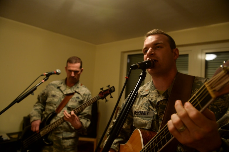 U.S. Air Force 2nd Lt. John McKinney, 52nd Aircraft Maintenance Squadron assistant officer in charge of the 480th Aircraft Maintenance Unit from New Ellenton, S.C., sings a song during a rehearsal session with Weekend Duty Jan. 29, 2014, at Spangdahlem Air Base, Germany. McKinney and U.S. Air Force Col . Matt Humes, 52nd Aircraft Maintenance Group commander, started the band during a New Years Eve party. (U.S. Air Force photo by Senior Airman Rusty Frank/Released)