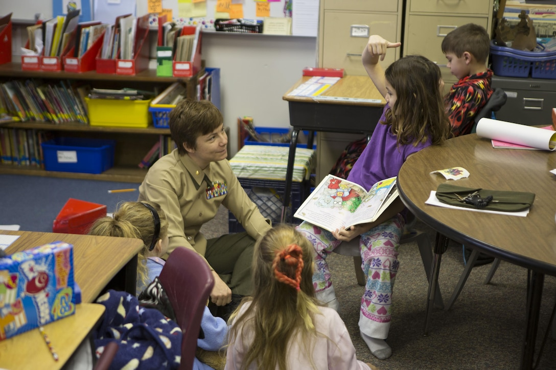 U.S. Marine Corps Maj. C. Faith Zimmerman, 26th Marine Expeditionary Unit (MEU) assistant logistics officer, interacts with students at Swansboro Elementary School as parts of the 26th MEU's partnership with the school in Swansboro, N.C., Feb. 14, 2014. (U.S. Marine Corps photo by Staff Sgt. Edward Guevara/Released)