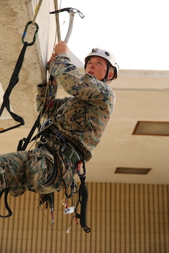 Cpl. Nick Rotherham, a team leader with the 11th Marine Expeditionary Unit's ground combat element, 2nd Battalion, 1st Marines, and a Merna, Neb. native, practices a traverse using and ice axe and étriers during the Assault Climber Course here Feb.12. A team of instructors trained Marines to become qualified assault climbers. Their new skillset is an asset gained for the 11th MEU's ensuing deployment later this summer.