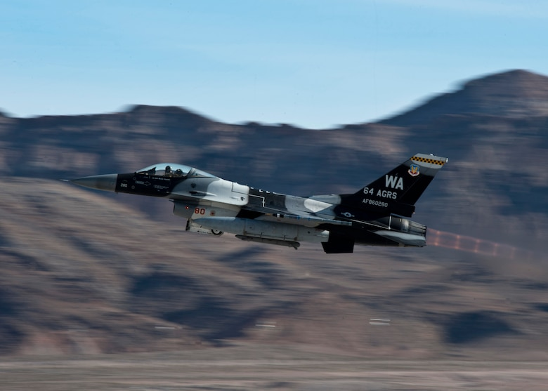 An F-16 Fighting Falcon takes off during Red Flag 14-1 on Jan. 28, 2014, at Nellis Air Force Base, Nev. The mission of the 414th Combat Training Squadron, the unit that plans and executes Red Flag, is to maximize the combat readiness and survivability of participants by providing a realistic training environment. There are approximately 125 aircraft participating in the exercise. The F-16 is assigned to the 64th Aggressor Squadron at Nellis AFB. (U.S. Air Force photo/Airman 1st Class Jason Couillard)