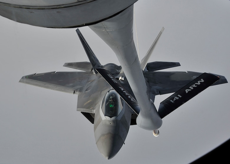 An F-22 Raptor from Hill Air Force Base, Utah, approaches a KC-135 Stratotanker refueling boom Feb. 7, 2014. The KC-135 provides the core aerial refueling capability for the Air Force and has filled this role for more than 50 years. The tanker is assigned to Fairchild AFB, Wash. (U.S. Air Force photo/Senior Airman Mary O'Dell)
