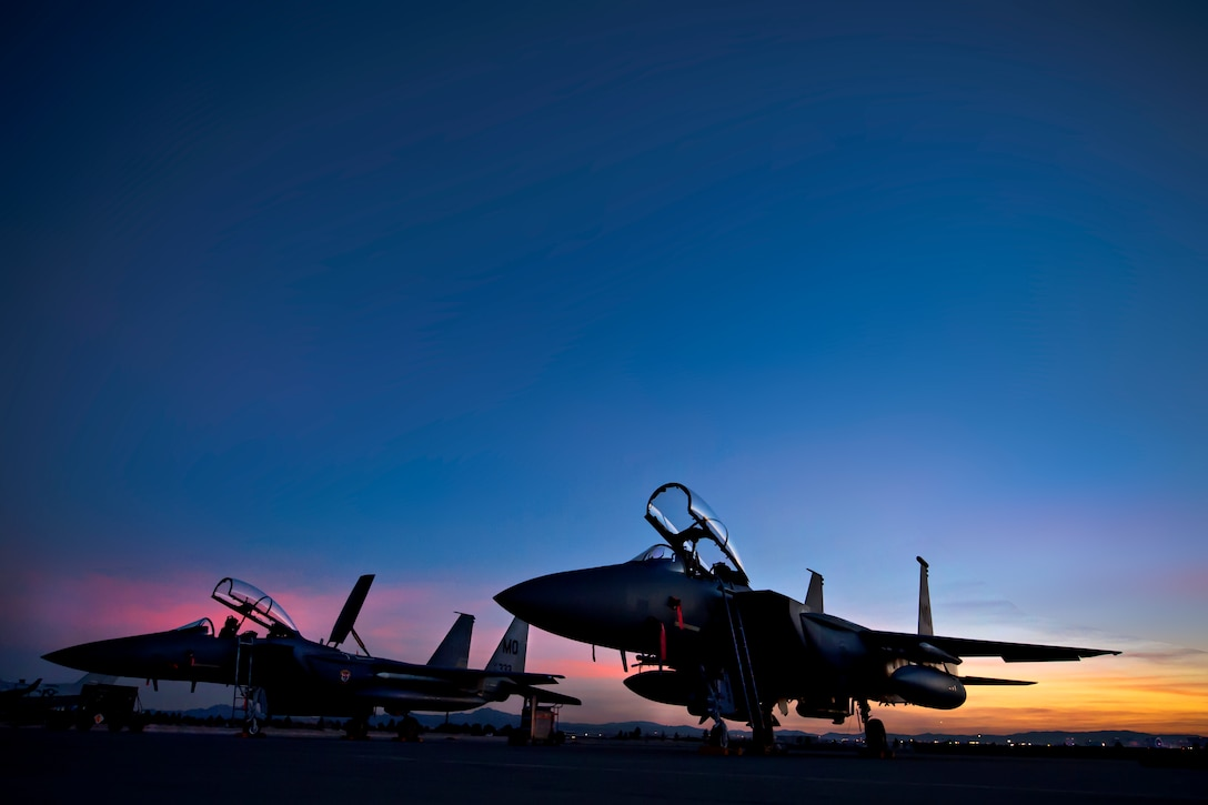 Two F-15E Strike Eagles are parked on the flightline Feb.10, 2014, as the sun sets over Nellis Air Force Base, Nev. More than 3,200 service members and 125 aircraft from joint U.S. and allied combat forces from around the world participate in Red Flag 14-1, hosted by the 414th Combat Training Squadron. The main objective of the exercise is to increase capabilities to defend against future threats.The F-15Es are assigned to the 391st Fighter Squadron, Mountain Home AFB, Idaho. (U.S. Air Force photo/Lorenz Crespo)