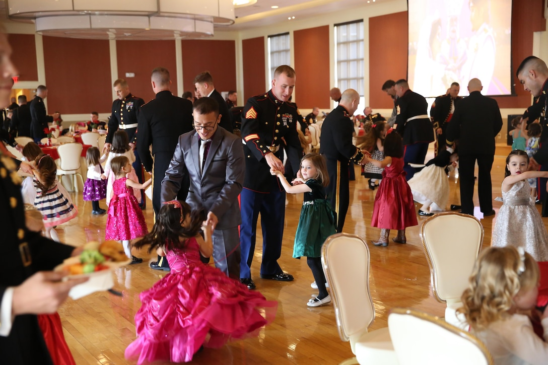 Fathers and daughters enjoy dressing up and dancing at the Tiny Miss Daddy-Daughter Dance held Feb. 8, 2014 at the Marston Pavilion aboard Marine Corps Base Camp Lejeune.