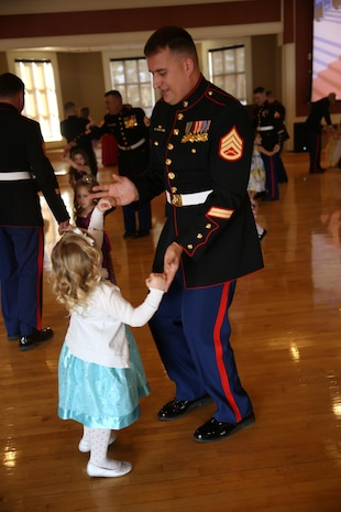 Staff Sergeant John Wallerich and his daughter Ava enjoy dancing at the Tiny Miss Daddy-Daughter Dance held Saturday, Feb. 8, 2014 at the Marston Pavilion aboard Marine Corps Base Camp Lejeune.