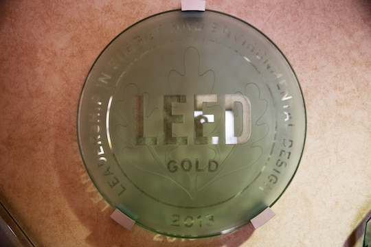 The Leadership in Energy and Environmental Design Gold plaque sits on the lobby wall at the Miramar Inn aboard Marine Corps Air Station Miramar, Calif., Feb. 13. The LEED certificate identifies establishments that have met certain environmental and energy conservational standards.