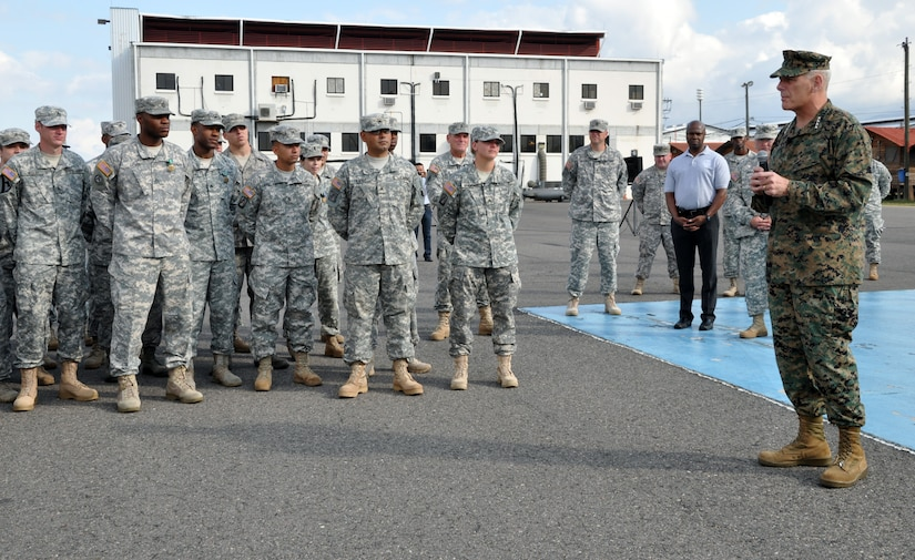 U.S. Marine Corps Gen. John F. Kelly, Commander, U.S. Southern Command, addresses the members of Joint Task Force-Bravo following a promotion and awards ceremony conducted on the flightline at Soto Cano Air Base, Honduras, Feb. 13, 2014. Kelly pinned new rank on six Task Force members who were promoted during the ceremony and presented medals, including the Army Commendation Medal, the Air Force Commendation Medal, and the Army Achievement Medal, to 18 members. (U.S. Air Force photo by Capt. Zach Anderson)