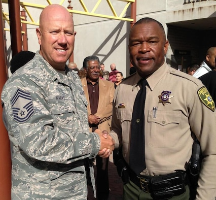 Chief Master Sgt. Brian Karas congratulates Master Sgt. Wendell Jones for graduating from the Sheriff's Department Academy Jan. 24.  Jones has dedicated himself to serve the Tucson community as both a sheriff and Air Guardsman. (Courtesy Photo)