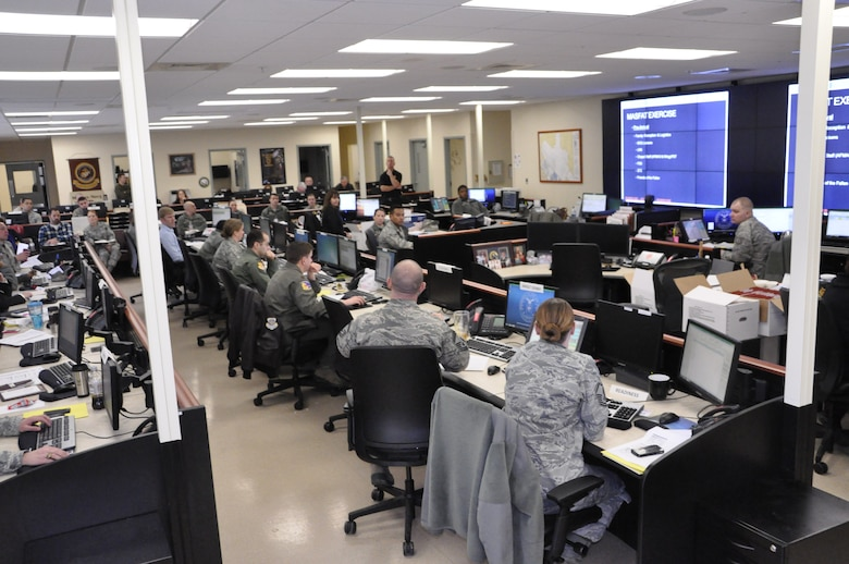 Personnel from Air Force Mortuary Affairs Operations, the 436th Airlift Wing and supporting agencies gather in the Command, Control and Communication Center at the Charles C. Carson Center for Mortuary Affairs, Dover Air Force Base, Del., for a mass fatality tabletop exercise Feb. 12, 2014. (U.S. Air Force photo/Staff Sgt. Chalanda Roberts)
