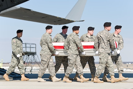 A U.S. Army carry team transfers the remains of Army Spc. John A. Pelham of Portland, Ore., Feb. 14, 2014 at Dover Air Force Base, Del. Pelham was assigned to the 2nd Battalion, 3rd Special Forces Group (Airborne), Fort Bragg, N.C. (U.S. Air Force photo/Roland Balik)